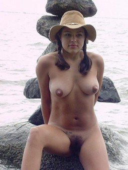 Busty beauty posing nude on the beach