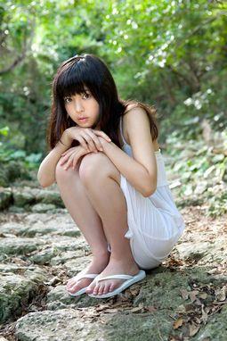 Moe Arai In White Dress Near Waterfall.