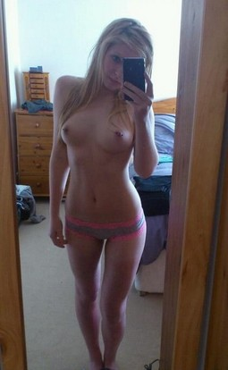 Smoking hot young blonde with pierced nipples.