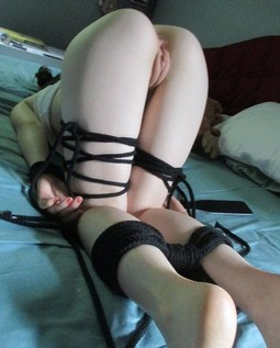Tied up and bent over.