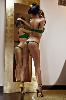 Skinny bimbo posing nasty with great ass in hot thong and with sexy breasts